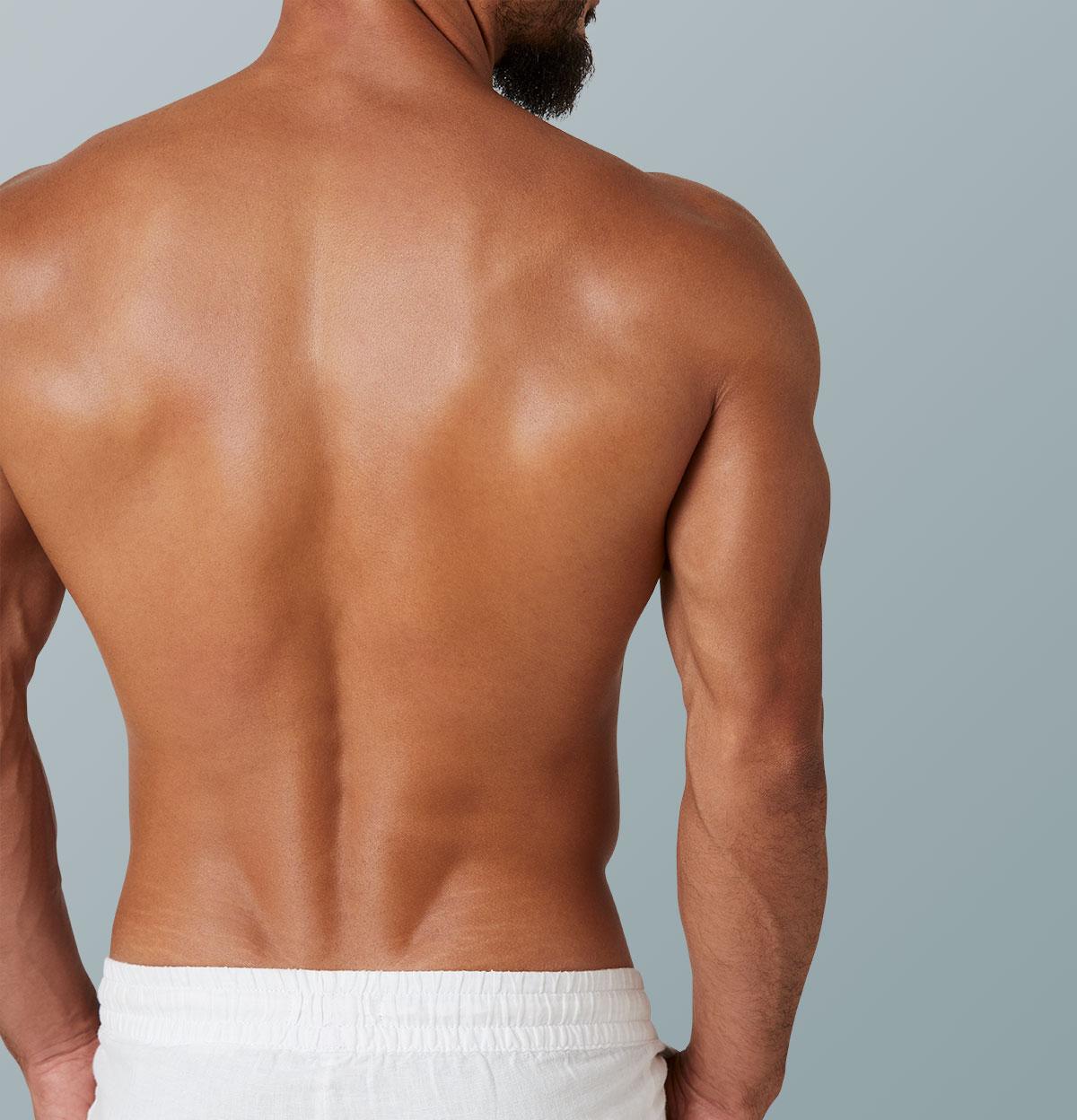 Rücken und Arm eines muskulösen Arms